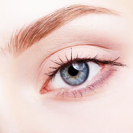 face shot: Closeup shot of female face makeup with blue eye