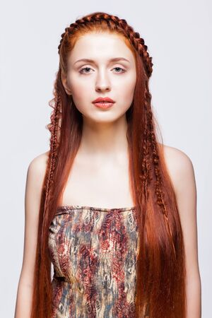 plait: Young ginger woman with red braids hairdo on white background