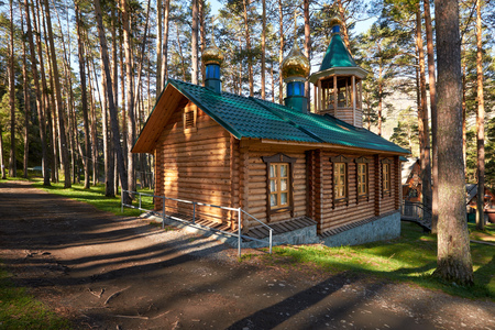 chemal: Wooden chapel of Makarii Altaiskyi in pine forest on the bank of river Katun in Chemal, Altai, Siberia