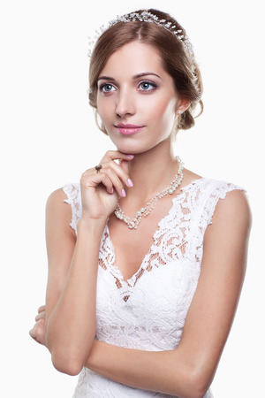 make up model: Portrait of beautiful young woman bride in white Wedding Dress on light gray background