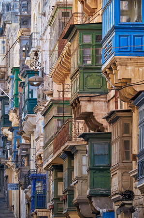 st pauls: Valletta, MALTA - JULY 24, 2015 A view of the traditional varicoloured maltese balconies of the St. Pauls street, Valletta
