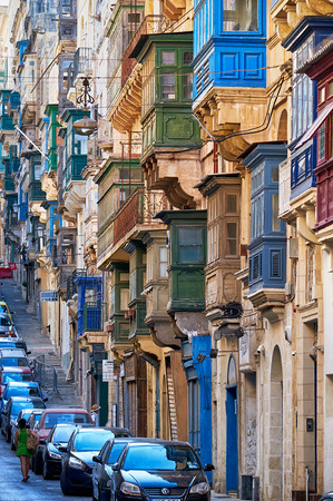 varicoloured: Valletta, MALTA - JULY 24, 2015 A view of the typical Street of Valletta  (St. Pauls street) with traditional varicoloured maltese balconies.