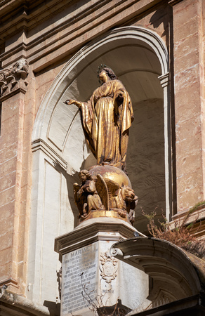 immaculate conception: Valletta, MALTA - JULY 24, 2015: The statue of Immaculate Conception on facade of the St Barbara Church in the Republic street, Valletta, Malta
