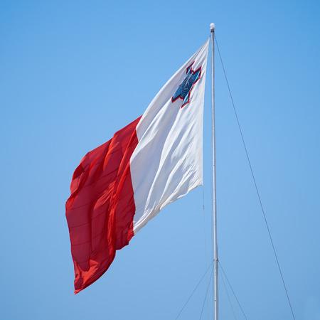 flagging: The bi-colour flag of Malta flaps over the Post of Castile in Birgu, Malta