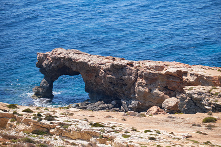 ras: The view of  natural stone arch of Ras il-Hamrija on Qrendi sea coast of Malta
