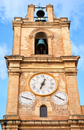 The bell and clock tower of St. John 's Co-Cathedral, showing the time and the day of the week and of the month. Valletta, Malta.