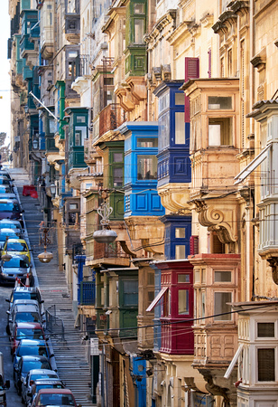 varicoloured: A view of the typical Street of Valletta  (St. Pauls street) with traditional varicoloured maltese balconies.