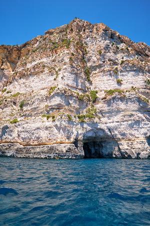 steep: Steep cliff over Mediterranean sea on south part of Malta island near Blue Grotto