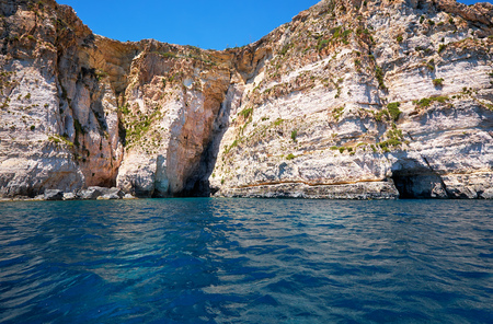 Steep cliff over Mediterranean sea on south part of Malta island near Blue Grotto