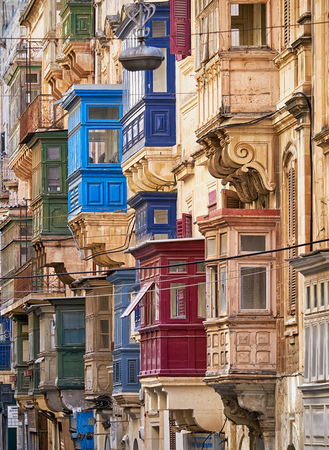 varicoloured: A view of the traditional varicoloured maltese balconies of the St. Pauls street, Valletta Stock Photo