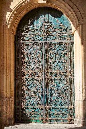 green door: The forged openwork metal lace door on the Grandmasters Palace, Valletta, Malta Editorial