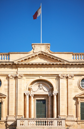 A balustraded balcony of the National Library of Malta with national flag, Valletta Editorial