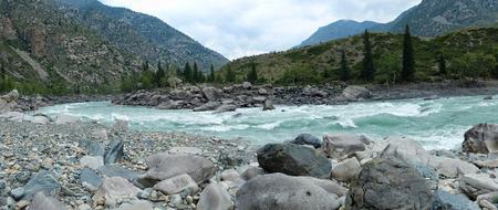 katun: Siberian  river Katun in Altai mountains at moody day Stock Photo