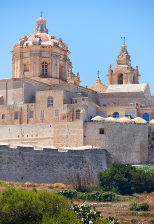 st   pauls cathedral: The view of the St. Pauls Cathedral in the old capital Mdina surrounding by the fortress wall from the countryside below. Malta