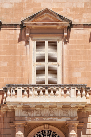limestone: A traditional Maltese style open balcony on one of the residential houses of Mdina. Malta. Stock Photo