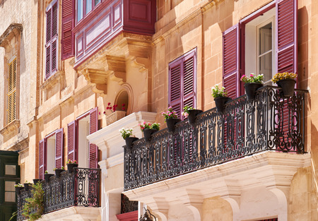 residential houses: A traditional Maltese style open balconies on one of the residential houses of Mdina. Malta. Stock Photo