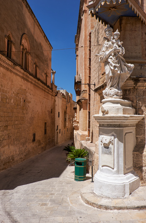 priory: Statue of Virgin Mary with Jesus child on the corner of Carmelite Priory also known as Our Lady of Mount Carmel in Mdina. Malta