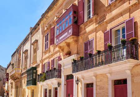 A traditional Maltese style open balconies on one of the residential houses of Mdina. Malta. Stock Photo