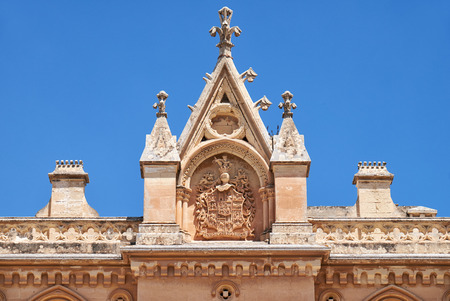 pawl: The wimperg (gable) decoreted with coat of arms and crockets above the portal to the Bishops Palace on the Pjazza San Pawl in Mdina. Malta