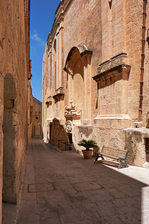 residential houses: In the limestone surroundings. The narrow medieval stone paved street and residential houses of Mdina, the old capital of Malta.
