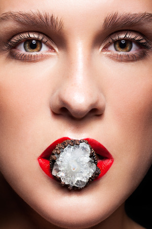 silken: Close up shot of bijouterie ring with stone in red female mouth lips