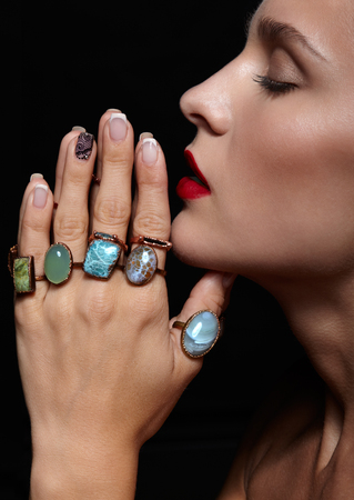 sundry: Young beauty woman  with  with many bijouterie rings with stones on fingers