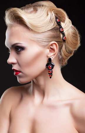 hairpin: Young blonde woman on dark background