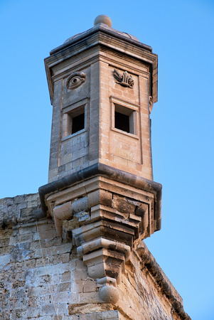 observance: The Guard tower Gardjola on the end of Senglea  peninsula bastion with sculpted symbols  (eye, ear and nose) representing guardianship and observance protecting the Maltese shores. Senglea, Malta Stock Photo