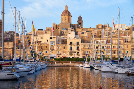 church of our lady: The view of Birgu (old capital Vittoriosa) with Our Lady of Annunciation Church (St. Dominics Church) big dome over the Dockyard bay with moored yacht. Malta