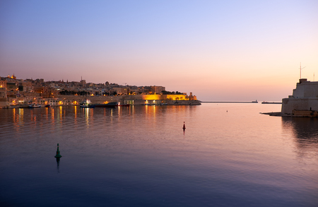 The early morning sunrise view of Valletta and the Grand Harbour (Port of Valletta) on Malta.