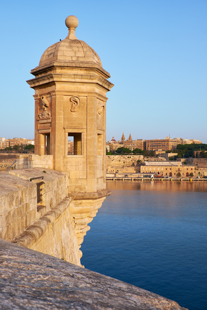 The Guard tower on the end of Senglea peninsula bastion with sculpted symbols  (eye, ear crane bird and nose) representing guardianship and observance protecting the Maltese shores. Senglea, Malta.