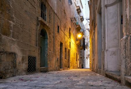 dawning: The narrow street Is - Sirena on Senglea city in the early morning. Malta