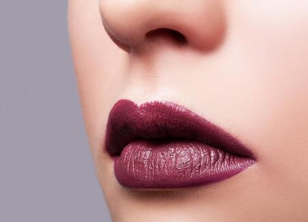 close shot: Close up shot of female purple lips