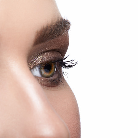 face shot: Closeup shot of female face with eye  day makeup