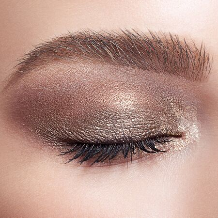face shot: Closeup shot of closed female face with eye  day makeup Stock Photo