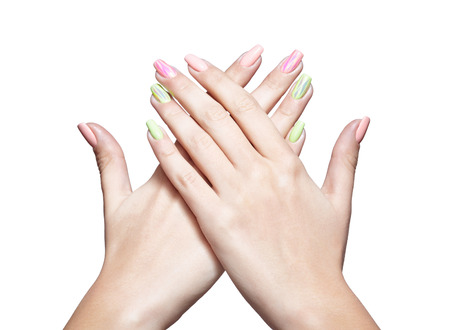 naildesign: Female hands with womans professional natursl pink and green nails manicure isolated on white
