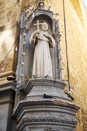 francis: VALLETTA, MALTA - JULY 24, 2015: The titular statue of St Francis of Assisi on the corner of St Francis of Assisi Church in Valletta, Malta