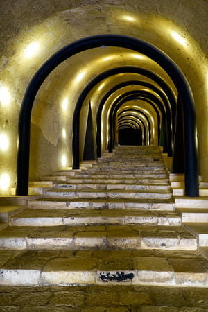 renovated: VALLETTA, MALTA - JULY 25, 2015:  An illuminated tunnel entrance leading to the St James Cavalier Centre for Creatvity. It is mediaeval fortress renovated into contemporary centre for creativity. Valletta, Malta Editorial