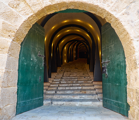 mediaeval: VALLETTA, MALTA - JULY 25, 2015:  An illuminated tunnel entrance leading to the St James Cavalier Centre for Creatvity. It is mediaeval fortress renovated into contemporary centre for creativity. Valletta, Malta Editorial
