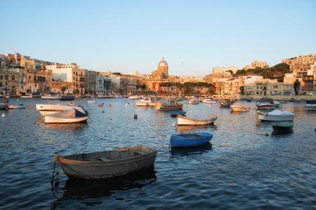 The view of the Kalkara bay between Birgu and Kalkara peninsula with the St Joseph church on the background, Malta.