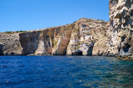 Steep cliff over Mediterranean sea on south part of Malta island near Blue Grotto