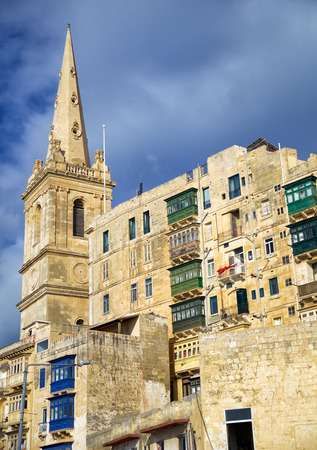 The view of the residential houses and the steeple of St. Pauls Anglican Cathedral â?? the main landmark of Valletta, Malta