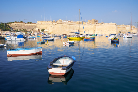 The morning view of Post of Castile from Kalkara over creek with the yachts and boats moored in the harbor.