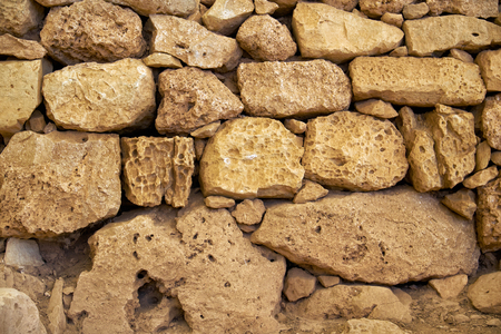 aragonite: The fragment of the sandstone blocks wall from the Mnajdra Temples, Malta