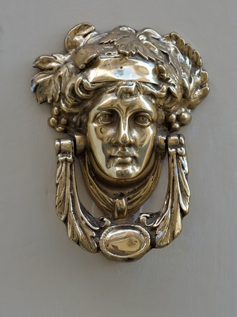 An old style decorative bronze door handles in the form of a beautiful womans head, the distinctive feature of Malta.