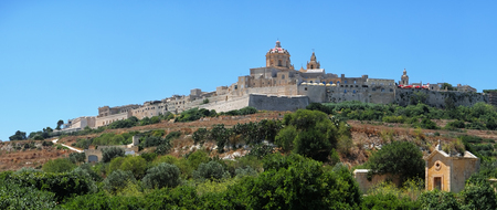 st pauls: Panorama of the old capital Mdina with St. Pauls Cathedral surrounding by the fortress wall from the countryside below. Malta