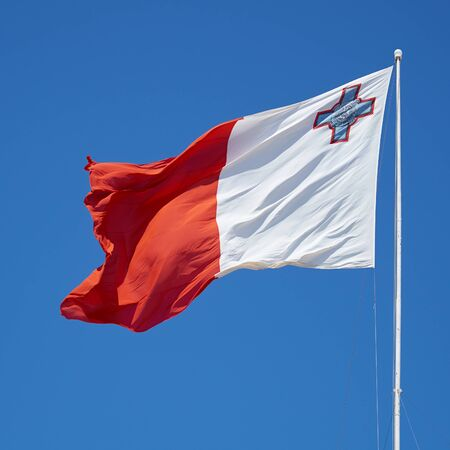 flagging: The bi-colour flag of Malta flaps over the Post of Castile in Birgu, Malta