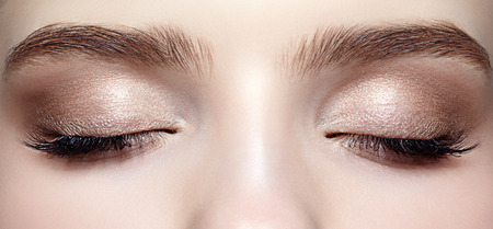 makeup eyes: Closeup shot of closed female face with eye  day makeup Stock Photo