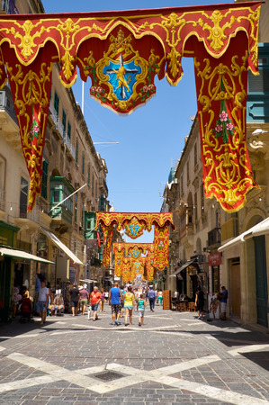 reale: VALLETTA, MALTA - JULY 31, 2015: The view of main Republic Street decorated for the holiday the Assumption of Virgin Mary, Valletta, Malta.