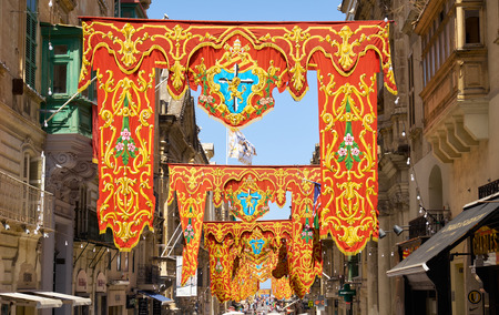 VALLETTA, MALTA - JULY 31, 2015: The view of main Republic Street decorated for the holiday the Assumption of Virgin Mary, Valletta, Malta.
